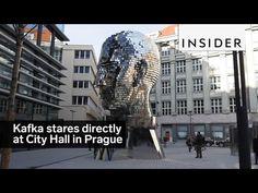 A sculpture of Franz Kafka's head faces City Hall in Prague - YouTube