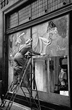 Window painter, a lost art. Circa 1949