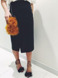 Accessorise midi skirts with Faux fur bags and lace up heels. #Topshop