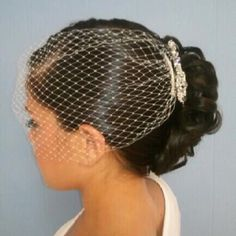 With bridal hairpiece