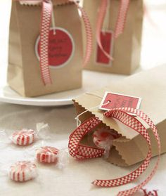 Brown paper bags decorated with ribbon, pinking shearsnad a matching handmade tag - cheap and very pretty.