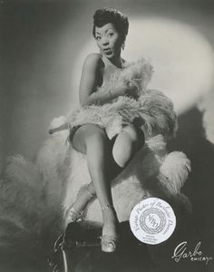 Jean Idelle (Cowan):     Often credited with being the first African American dancer to perform in integrated shows. She performed her famed fan dance all over the USA and Canada during the 1950s and 1960s, including headlining Minsky's Riatto Theater in Chicago. Jean would eventually retire from burlesque to devote her energy to raising her family.    At the age of 82, Jean Idelle came out of retirement to perform her act one more time at the 2012 Burlesque Hall of Fame Weekend.