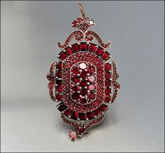 This is from one of my favorite vintage & antique jewelry sellers - Alicia Boyle. Isn't it gorgeous?  Victorian Garnet Brooch Locket Pendant Large Antique by boylerpf, $850.00