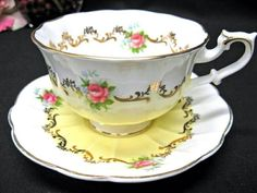 Sweet yellow and rose design teacup...