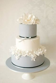 Grey shade cake   LOVE the flower details on the bottom layer. Simple yet detailed at the same time. Classy & fun at the same time. Great cake, could be done in many color combinations, but should be kept in soft shades I think.