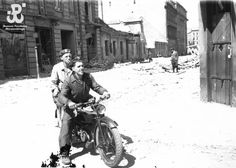 9 August 1944, Insurgents on a motorcyle at the corner of ul. Jasna and ul. Świętokrzyska, the view  is towards Plac Dabrowski.