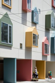 Bay windows with colourful house-shaped frames extend from the front of this nursery school in the city of Sendai, which was designed by Tokyo-based architect Masahiko Fujimori.