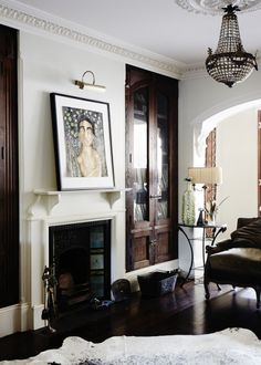 How To Live Lovely- built ins dark wood living room doors