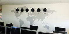 World map office wall mural installed with clocks and acrylic plaques showing time zones around the world. This effecti wall mural was installed by Space3.co.uk