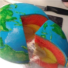 Earth Structural Layer Cake by cakecrumbs: The red layer is orange Madeira sponge, the yellow is lemon Madeira sponge and the white cake was a vanilla buttercake! #Earth #Cake