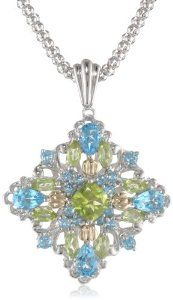 "S Sterling Silver and 14k Yellow Gold Licensed Blue Topaz and Peridot Pendant Necklace, 18"" ~  5 out of 5 stars   (8 customer reviews) ~  List Price:	$ 499.00 ~  Price:	$149.00 & FREE Shipping and Free Returns.  ~  You Save: $ 350.00 (70%)"
