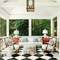 Freestanding Summer House Porch | Architect Norman Askins and interior designer Craig Duncan created this sophisticated summer house patio in Atlanta. Their inspiration came from the work of designer Dorothy Draper. The bamboo picture molding added to the mirror references her furniture designs. | SouthernLiving.com