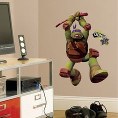 Bring the ultra intelligent Donnie to the walls of any Teenage Mutant Ninja Turtles fan with this giant wall decal. This huge wall graphic of Donatello is easy to apply, remove, and reposition. It sti