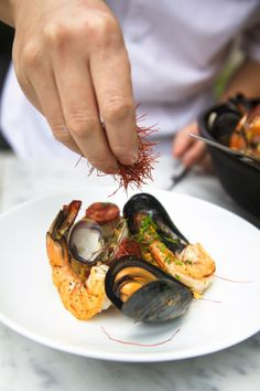 Paella launching Spanish Paella Day Sunday Super Series at Boulevard Kitchen & Oyster Bar