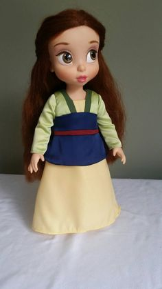 **This is a made-to-order item. I have on hand all the materials and supplies needed to make it. If you would like to order one, it will be identical to the one pictured here and should be ready to ship in about a week. Thank you**  Transform your doll into Mulan with this replica of her green and yellow kimono. This is a one-piece dress. Satin, matte or shiny, is used for the light green, blue and red sections while the other sections are made using polyester crepe fabric. The bodice of…