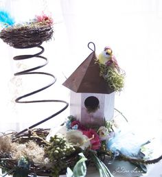 Rusty bed coils with a tin bird house makes a fun centerpiece.
