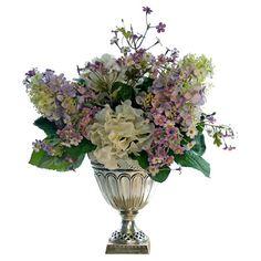 Faux lilac and hydrangea arrangement in pedestal vase.   Product: Faux floral arrangementConstruction Material: Silk...