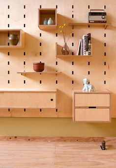 Kerfwall modular storage wall. Wall and hanging components made of plywood with either maple or walnut hardwood veneer. Made by Kerf Design in Seattle, WA. Free shipping. kerf-wall.myshopify.com kerfdesign.com