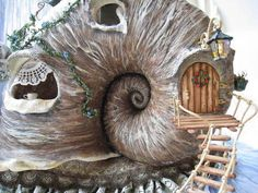 Snail house miniature. This Russian lady from Petrozavodsk, Russia, now living at Helsinki, Finland has made this stunning mini-snail house.