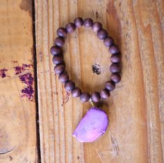 Wood bead bracelet with violet natural stone pendant by BartlebyandDyl on Etsy https://www.etsy.com/listing/549961765/wood-bead-bracelet-with-violet-natural