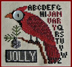 Hinzeit Jolly January (Bird's Eye) Cross Stitch Pattern. Model stitched on 28 Ct. Lambswool Jobelan using DMC floss. Stitch count 52x52. Chart comes with button