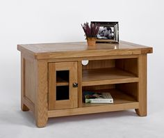 Devon Oak Small TV Unit The Devon Oak Small TV Unit has a compact and chunky structure complete with a substantial open storage space on one side and a small cupboard on the other. Each section has one shelf and would provid http://www.MightGet.com/january-2017-13/devon-oak-small-tv-unit.asp