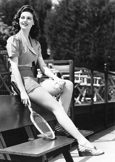 Actress Ava Gardner looking radiantly gorgeous as she takes a breather during a game of tennis (1940s).