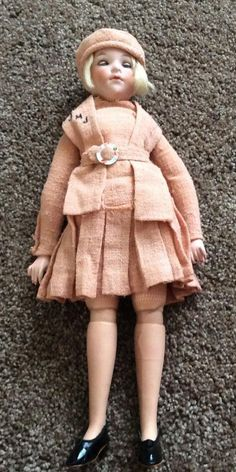 13  Armand Marseille German doll. Bisque head, jointed composition limbs and body. Clothing in very good condition, appears to be original (?). Blue eyes that open and close. Doll was part of my mothe