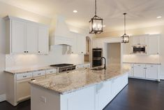 Love the granite with the white cabinets and lighting