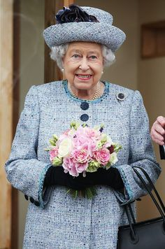 Queen Elizabeth looks elegant in a blue tweed coat and matching hat as she opens a roof garden at Aberdeen Royal Infirmary on September 29, 2017