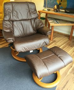 Vegas Recliner in Paloma Chocolate with Teak base. Available at Scanhome Furnishings in Green Bay.