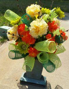 Colorful vase cemetery arrangement