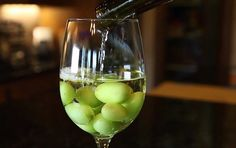 frozen grapes in wine keep wine cold and no ice cubes to dilute the wine!