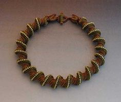 Spiral Necklace - see closeup of 'dragon claw' rope ends & clasp