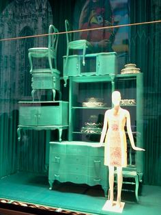 Painted furniture and mannequin makes a great front window display. Green Show window Milan, Spring 2013