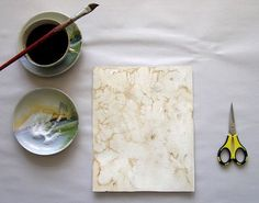 give maps, prints and paper of all kinds an unusual, antique look. strong brewed coffee or even tea will work. Begin painting a region of the paper using the espresso. While the region is still damp, gently sprinkle on salt crystals.