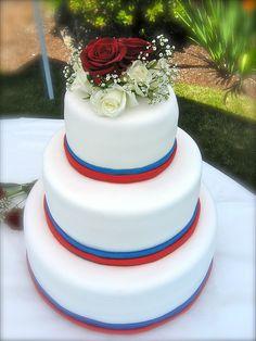 Fourth of July themed wedding cake. White fondant, red and blue fondant ribbon. by ArtisanCakeCompany, via Flickr