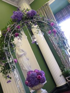 Hazlewood Castle wrought iron arch with scented flowers