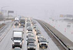 Record Southern California rain swamps roads, swells rivers