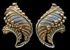 Arts and Crafts clips. Silver and copper. H: cm in) W: cm in). British, c. Sold by Tadema Gallery.