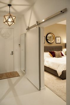 , Marvelous Modern Bedroom Designs Also Antique White Wall And Door Color With Contemporary Sliding Door Design With Stainless Rails Also Artistic Pendant Lamp Design Also Modern Quen Size Bed Also Beige Rug: Tremendous Mens Bedroom Ideas Modern Bedroom Design, Contemporary Bedroom, Contemporary Barn, Bedroom Designs, Bedroom Ideas, Bedroom Decor, Barn Style Doors, Barn Doors, Sliding Doors