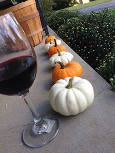 Turn of the season. Front porch, fall, wine , pumpkins.