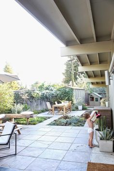 hardscaped back yard with pockets of socializing areas and greenery
