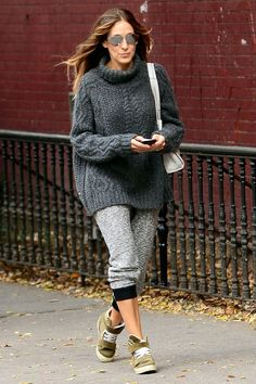 "9 Style Lessons We Can Learn From Sarah Jessica Parker #refinery29  http://www.refinery29.com/sarah-jessica-parker-best-outfits#slide-3  Baggy Doesn't Mean BadA cozy, oversized turtleneck with sweats and sneakers would fall under our ""lazy girl"" wardrobe. But, SJP makes a convincing case for the daytime, athleisure-inspired look: The cropped fit on the pants give her calves some definition, while her seriously cool kicks and mirrored sunglasses add some edge to the overall ensemble.Sarah…"