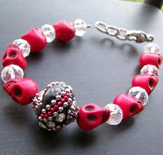 This beautiful inch sugar skull bracelet is highlighted by a large crystal embellished black and red bali bead surrounded by red sugar skulls and clear faceted crystal beads. Sugar Skull Halloween, Sugar Skull Art, Sugar Skulls, Mexican Skulls, Skull Bracelet, Beaded Skull, Halloween Jewelry, Large Crystals, Bead Jewelry