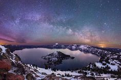 """• """"The Lights II"""" • Prints are also available of this image of the milky way and northern lights above Crater Lake in my online store. I shot this image March 18th, 2015. I hiked/snowshoed about 3.5 miles each way, leaving Rim Village around 1am arriving at the summit of Watchman Peak at around 3am. After shooting two panos atop the Peak, I made the trek back to Rim Village. What most people don't know about this outing is that once I arrived at Rim Village, I hopped into my car drove back…"""