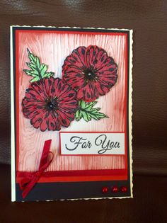 Sheena Douglas poppy dies with matching stamp. Used distressed ink on embossed background...
