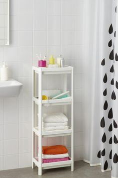 The IKEA VESKEN shelf unit has high edges on all sides to keep everything - from towels to toothbrushes - in place! A little extra bathroom storage space is always a good thing!