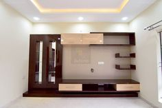 TV Unit created as per design, with wall paper and mirrors, false ceiling