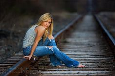 senior girls  posing on railroad tracks | quintessentially inappropriate - Neil vN - tangents
